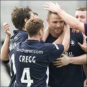 Falkirk midfielder Michael Higdon is congratulated by his team-mates