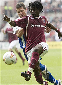 Hearts midfielder Laryea Kingston (front) grapples with Kilmarnock's Grant Murray