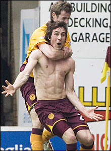 Motherwell's Darren Smith takes his shirt off to celebrate his opening goal