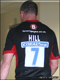 Richard Hill walks off the pitch in Milton Keynes