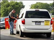 Police check a car at Bush ranch, Crawford TX