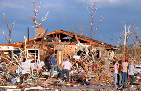 Residents survey the damage from a tornado that ripped through the town of Picher, Oklahoma, 10 May, 2008