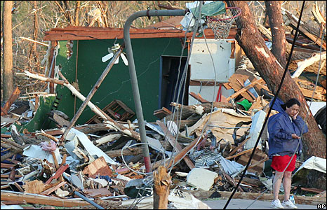 A woman contemplates the damage from a tornado that ripped through the town of Picher, Oklahoma, 10 May, 2008