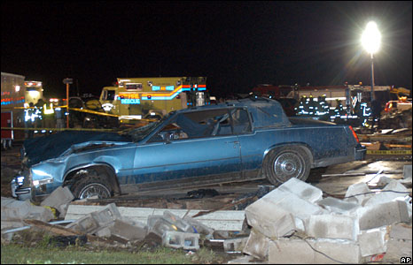 A car sits where a house once was after a deadly tornado swept through south-west Missouri near Seneca, 10 May, 2008