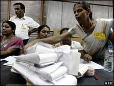 Sri Lankan polling officers prepare final result documents at a counting centre in the eastern Sri Lankan province of Trincomalee on 11 May, 2008