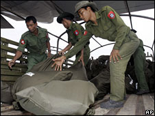Burmese soldiers unload bags of aid from a Thai military plane onto a truck at Rangoon airport, 11 May, 2008