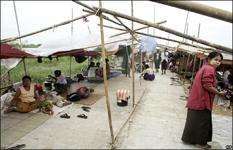 Families who survived the cyclone stay in a temporary shelter on the outskirts of Rangoon