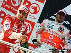 Lewis Hamilton looks on as Felipe Massa celebrates victory in the Turkish Grand Prix