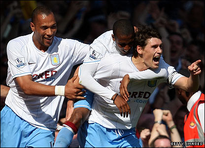 Gareth Barry celebrates scoring the second for Villa