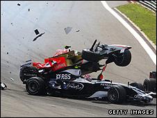 Giancarlo Fisichella's Force India flies over the back of Kazuki's Nakajima's Williams at the first corner of the Turkish Grand Prix