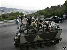 Lebanese troops head for Choueifat, near Beirut, to halt the Hezbollah-Druze fighting on 11 May