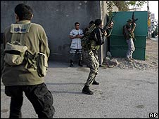 Shia gunmen take position during fighting with Druze forces in Choueifat, near Beirut, on 11 May