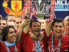 Carlos Tevez, Ryan Giggs and Cristiano Ronaldo celebrate Manchester United's Premier League title victory with the rest of the team
