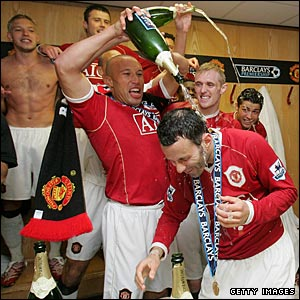 Mikael Silvestre leads the celebrations in the United dressing room