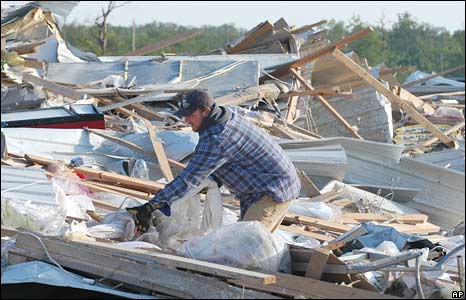 A man picks through the rubble of a house in Seneca, Missouri. Photo: 11 May 2008