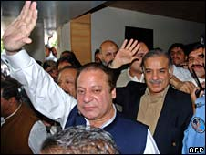 Nawaz Sharif (L) and his brother Shahbaz Sharif wave to supporters upon arrival from London, in Islamabad on May 12, 2008.