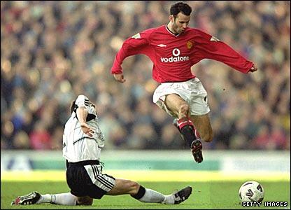 Ryan Giggs leaps over Fulham's Steve Finnan