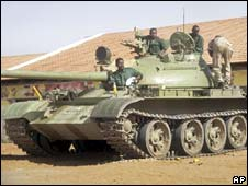 A Sudanese tank sits in position in Khartoum's twin city of Omdurman