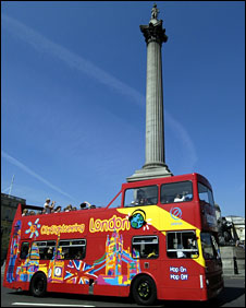 Tourists on a London sight-seeing bus near Trafalgar Square