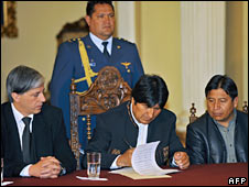 President Evo Morales signs the referendum bill into law on 12 May
