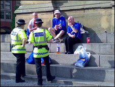 Fans with police
