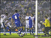Leeds striker Dougie Freedman (left) scores a late goal in the 2-1 defeat to Carlisle in the first leg of their League One sem-final play-off