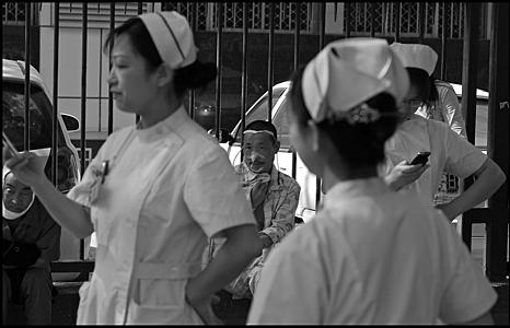 Nurses wait outside hospital. Photo: Chris Cherry