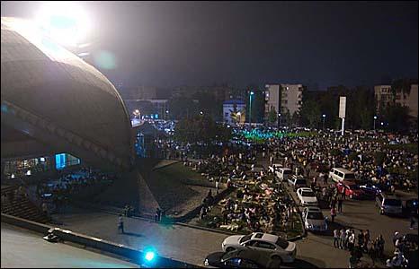 Crowds form at a football pitch. Photo: Daniel Ebbutt