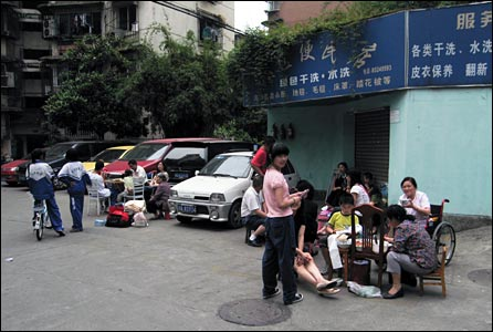 Chengdu residents in the street. Photo: Andrew Garde Joia