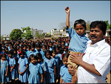 Bandhu Tirkey with school children