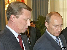 Russian Prime Minister Vladimir Putin (right) speaks with Deputy Prime Minister Sergei Ivanov