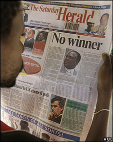Man reads the Zimbabwean State owned daily newspaper, The Herald, in Harare, Zimbabwe, May, 3, 2008.