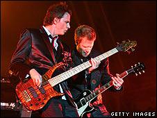 Duran Duran's John Taylor (left)