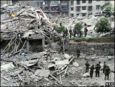 Chinese rescuers search a collapsed building for survivors in Beichuan, Sichuan province, on Tuesday