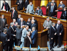 MPs block the podium in Kiev's parliament building