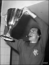 Rangers legend Colin Stein holds aloft the European Cup-Winners' Cup