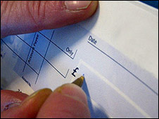 A cheque being written out