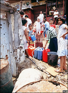 Palestinian refugees queue up for clean water in the camp of Shatila, 1985