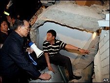China's Prime Minister Wen Jiabao (left, with megaphone) at a collapsed hospital in Dujiangyan - 12/5/2008