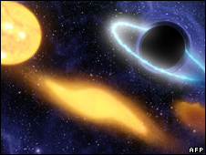 Artist's impression of a black hole at the centre of a remote galaxy (NASA handout - file image)