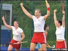 GB women's hockey players celebrate
