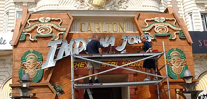 Men working on Indiana Jones sign