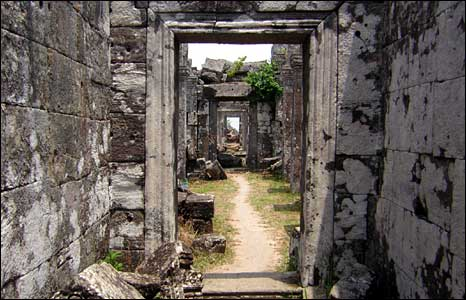A stone corridor runs through a series of chambers in one of the structures