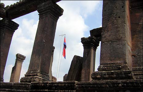 A Cambodian flag flies inside one of the lower entrance buildings