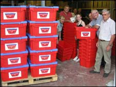 Water survival boxes stacked at the Midsomer Norton depot