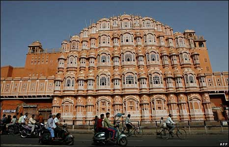 People drive past Jaipur's landmark Hawa Mahal before the curfew in the old city area in Jaipur on May 14, 2008