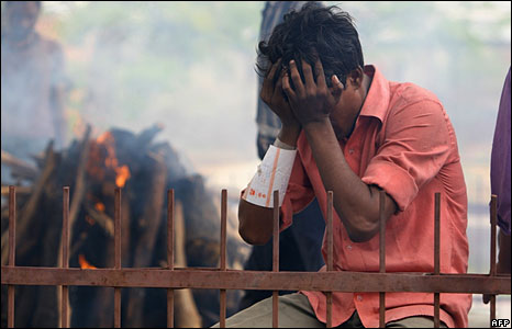 A man mourns for his dead father who died in the blast