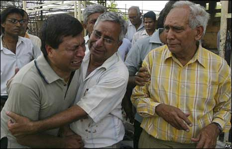 Relatives grieving outside a crematorium in Jaipur
