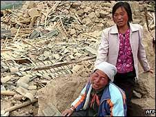 Chinese farmers in front of their destroyed home in Longnan, Sichuan province