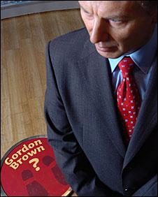 A waxwork of Tony Blair near a place for Gordon Brown
